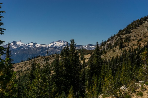 Viewed from Garland Peak TR:  Upper reaches of Basalt Ridge in the distance/foreground with Glacier Peak in the background
